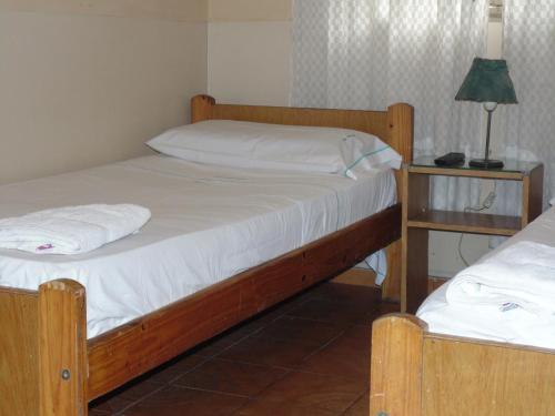 Una cama o camas en una habitación de Hotel Plaza Garay