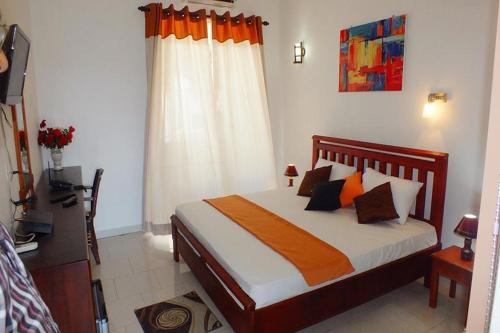 A bed or beds in a room at WindMill Beach Villa and Hotel