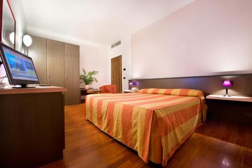 Letto o letti in una camera di Hotel Campelli