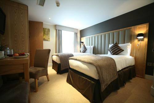 A bed or beds in a room at Best Western The Boltons Hotel London Kensington