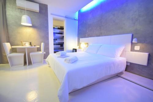 Un ou plusieurs lits dans un hébergement de l'établissement Design&Art Pie'