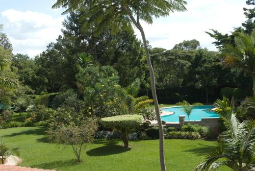 A view of the pool at House of Waine or nearby