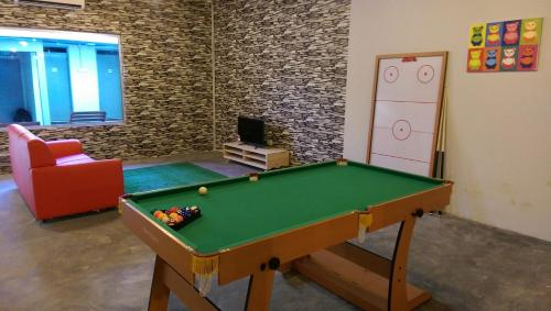 A billiards table at Wassup Youth Hostel