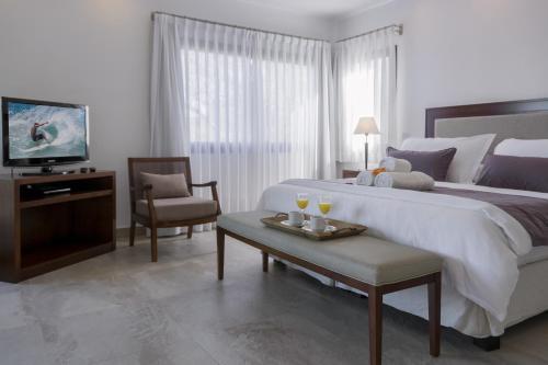 Una cama o camas en una habitación de Ville Saint Germain Apart Hotel & Spa
