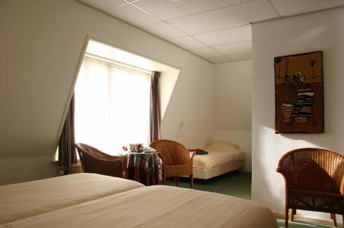 A bed or beds in a room at Pension Westerburen