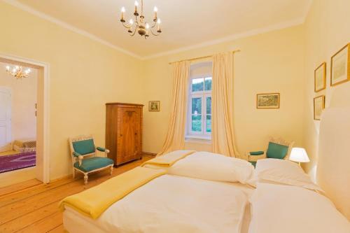 Ein Bett oder Betten in einem Zimmer der Unterkunft Meierhof