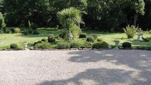 A garden outside Manoir La Haie Chapeau