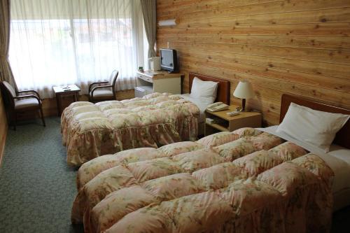 Cama o camas de una habitación en Sansuikan Kawayu Midoriya