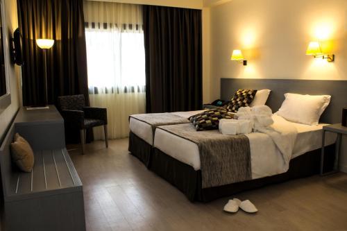 Cama o camas de una habitación en Hotel Black Tulip - Porto Gaia