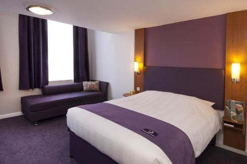 A bed or beds in a room at Premier Inn London Stansted Airport