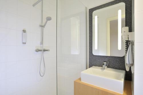 A bathroom at ibis De Panne