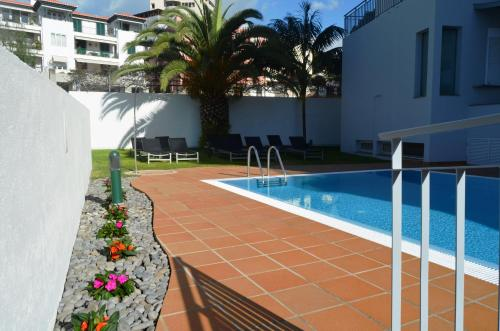 The swimming pool at or close to Madeira Bright Star by Petit Hotels