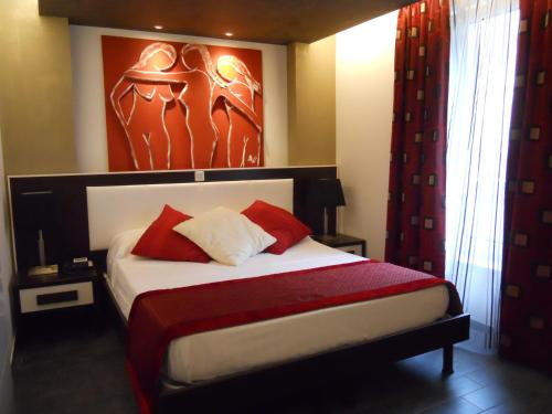 A bed or beds in a room at AppartHotel Belle Vue