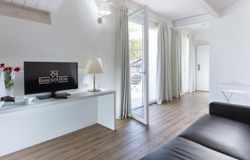 A television and/or entertainment center at Rimini Suite Hotel
