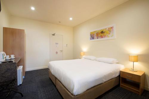 A bed or beds in a room at Nightcap at High Flyer Hotel