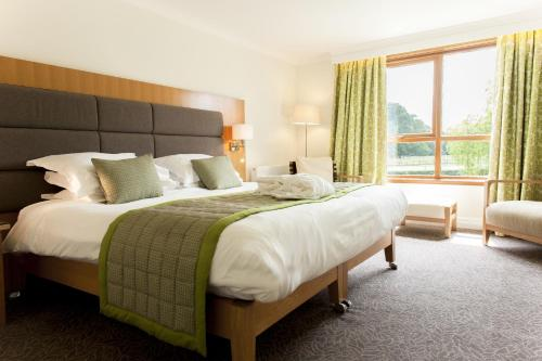 A bed or beds in a room at Champneys Tring