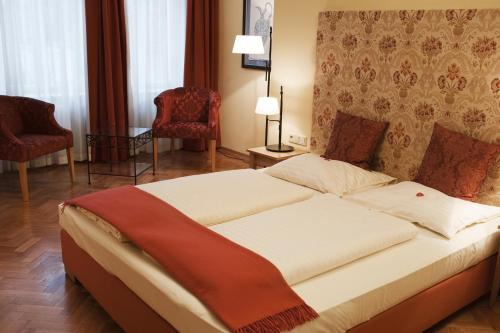 A bed or beds in a room at Hotel Villa Florentina