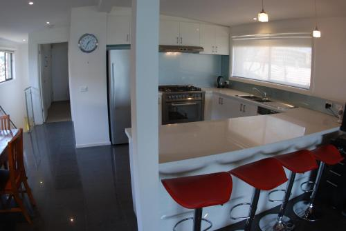 A kitchen or kitchenette at Award Winning Beach Front Retreat