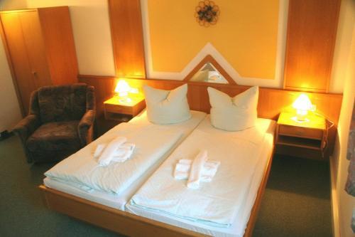 Ein Bett oder Betten in einem Zimmer der Unterkunft Hotel Asterra