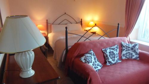 A bed or beds in a room at Caheroyn House