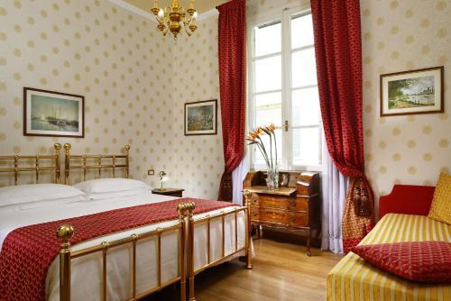 Ein Bett oder Betten in einem Zimmer der Unterkunft Hotel Pendini