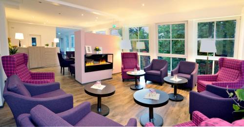 Ein Sitzbereich in der Unterkunft Hotel Bleske im Spreewald