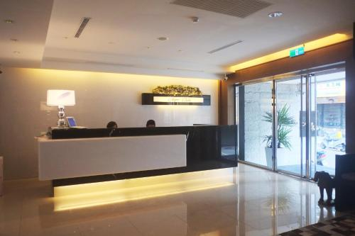 The lobby or reception area at Aqua Bella Hotel