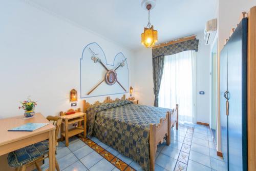 Letto o letti in una camera di Albergo Pensione Riviera