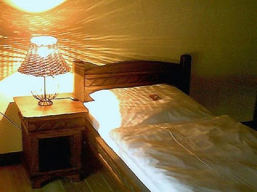 Ein Bett oder Betten in einem Zimmer der Unterkunft Vielanker Brauhaus
