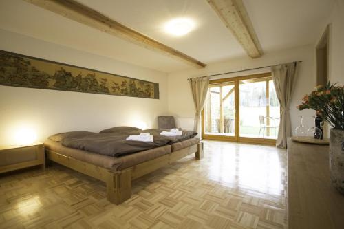 Ein Bett oder Betten in einem Zimmer der Unterkunft Apartments Wolkentor