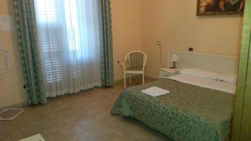 Letto o letti in una camera di B&B Manzoni Resort