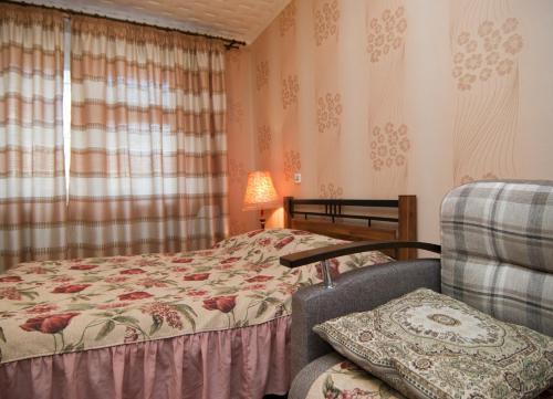 Кровать или кровати в номере Uyut Apartments Chekhova