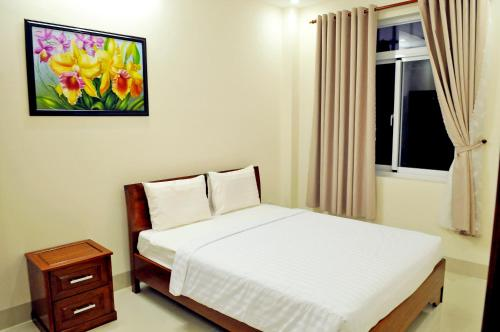 A bed or beds in a room at Lotus Apartment Hotel