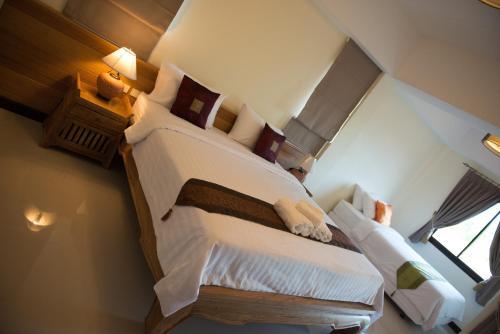 Кровать или кровати в номере Chivapuri Trat