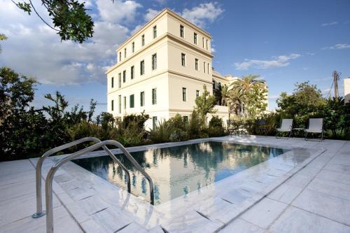 The swimming pool at or near Poseidonion Grand Hotel