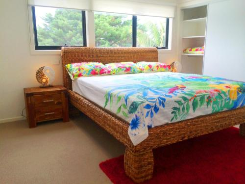A bed or beds in a room at Award Winning Beach Front Retreat