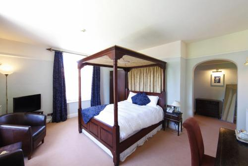 A bed or beds in a room at Hadley Park House Hotel