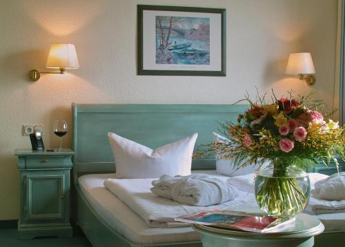Ein Bett oder Betten in einem Zimmer der Unterkunft Hotel Frauenberger