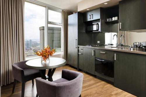 A kitchen or kitchenette at One King West Hotel and Residence