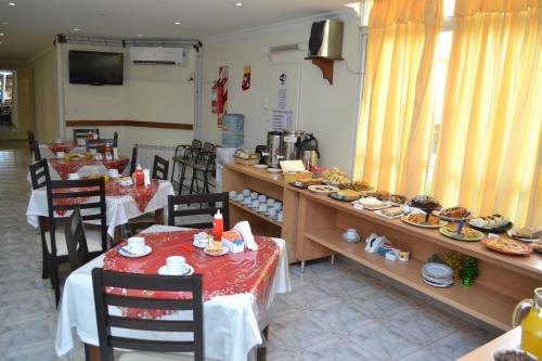Un restaurant u otro lugar para comer en Apart Hotel Patagonia Sur