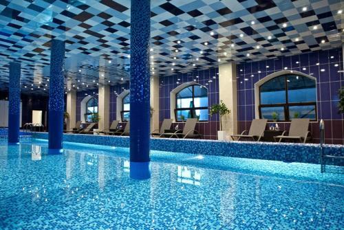 The swimming pool at or near Vyshegrad Castle Hotel