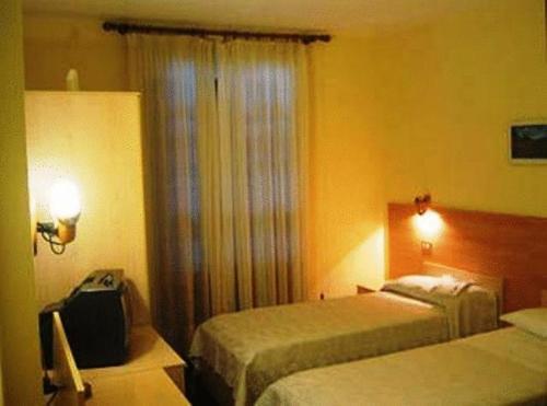 Letto o letti in una camera di Hotel Quo Vadis