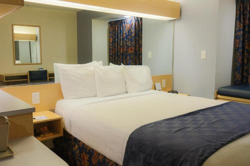 A bed or beds in a room at Microtel Inn & Suites-Conyers
