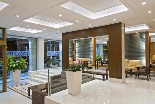 The lobby or reception area at Kydon The Heart City Hotel