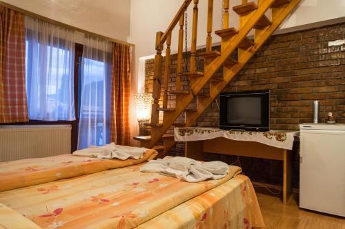 Кровать или кровати в номере Villa Vera Guest House