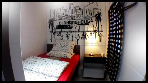 A bed or beds in a room at Micro Hotel
