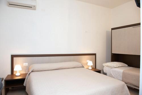 Letto o letti in una camera di Domo - Guest-House Il Nespolo Fiorito