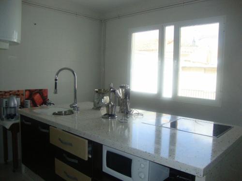 Una cocina o zona de cocina en Casa De Comedias