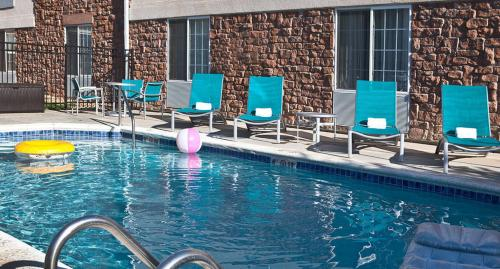The swimming pool at or near TownePlace Suites Colorado Springs