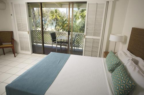A bed or beds in a room at Beachfront Terraces Exclusive Onsite Reception and Management